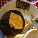 This overdone burger and tiny piece of 'plastic' cheese is supposed to be a cheeseburger !!!