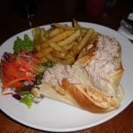 Baguette with tuna mayonnaise and chips.