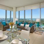 The Deluxe Bay Front Suite features floor-to-ceiling windows with expansive bay and city views