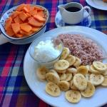 Breakfast: porridge with papaya and rice with curd and banana. Delicious!