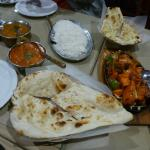 The meal with plain naan (foreground) and garlic bread (behind)