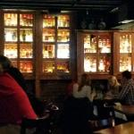 Downstairs bar with wall of bourbons
