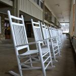 Porch chairs overlooking golf course.