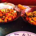 Combination portions of Kung Pao and curry chicken. Full size entrees.