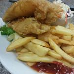 This is their fish n chips dinner!!!! 2 large filets, cole slaw, fries and hush puppies. Batter