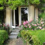 Porta de vidro da sala de estar que dá para o jardim