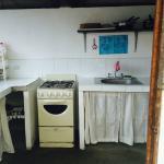 Full kitchen with fridge