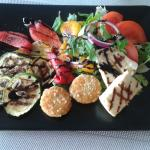 Salad with halloumi cheese , breaded camembert cheese and grilled vegetables
