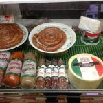 The homemade sausage plus imported meats in the deli case...