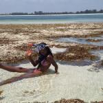 We were sunbathing on the reef opposite Galu Getaway. Transport is best by local dhow.
