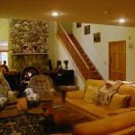 Relax in Great Room with fireplace, home theater and dining facilities