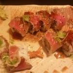 warm tempura shrimp inside,  lightly toasted tuna outside. delicious!