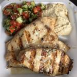 Fish meal with two sides: tabbouleh and hummus.  Garlicky king fish - really good!  Much overloo