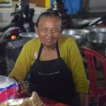 A local lady who was cooking our dinner in a market stall