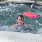Daughter enjoying hot tub