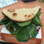 1/2 turkey sandwich on flat bread.  Mostly greens, very little turkey