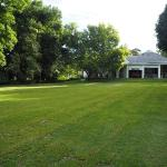 Green carpet welcome: the late sun lingers on the luxuriant lawn lapping at the front stoep..