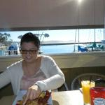 Friend enjoying breakfast and view