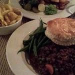 Fish and chips, and steak mince pie with fries