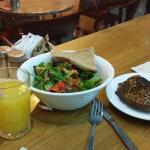 Antipasti salade and samousak or empanada and orange juice