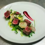 Steak salad with fresh goat cheese and wild berries gel