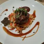 Grilled beef steak, served with roasted root vegetables and red wine-truffle sauce