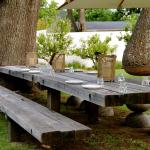 Relax under the trees at the big table - perfect!
