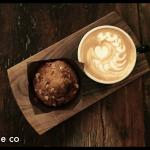 cappuccino paired with muffin in house baked