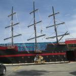 The pirate ship is in the back parking lot.