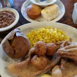 Fried fish, corn, pinto beans, bake sweat potato. Biscuits
