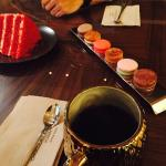 Coffee, macaroons and red velvet cake