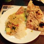 Chicken and vegetable korma with naan bread and popadums