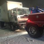 My truck being towed to the truck shop near Baymont Inn