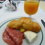 Breakfast - Orange juice, croissant, ham, cheese