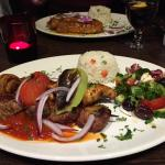 Mixed kebab with duck main in the background