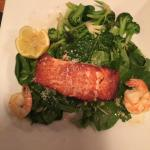 Pan Seared Salmon with Wilted Spinach and Broccoli.  Garnished with Shrimp.