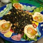 Tagliolini al nero di seppia con code di scampi branzino e pomodorini