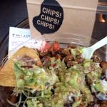 Burrito bowl with tortilla chips.