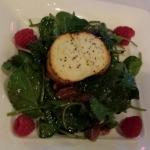 Goat cheese spinach salad with fresh raspberries, nuts & a delightful bacon vinagrette.