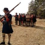 Reenactment - soldiers explaining muskets loading and firing