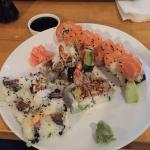 Spicy tuna roll, tempura roll and salmon roll.