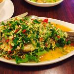Steamed Tilapia topped with chopped chilli garlic and cilantro in lemon sauce.