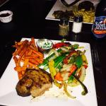 Medium Filet mignon with sweet potato fries and grilled pepper and onion. Best steak we have eve