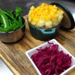 """Braised duck """"pie"""" with cheddar mash and pickled red cabbage"""