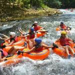 Riding the waves in a tube down the Rio Bueno River Rapids Jamaica in Trelawny