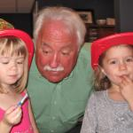 Molly, left, and Peyton have breakfast with Grandpa Gordie W