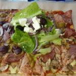 Delicious pizza with greek salad topping....