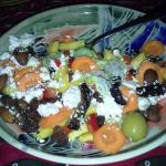 African salad includes veggies, fruits, nuts and feta!