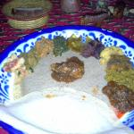 Injera Mixed includes crepes for eating a sampling of fish, chicken, lentils, veggies, and curri