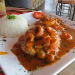 Delicious fish with calamari and red sauce